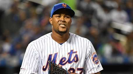 Mets relief pitcher Jeurys Familia reacts as he