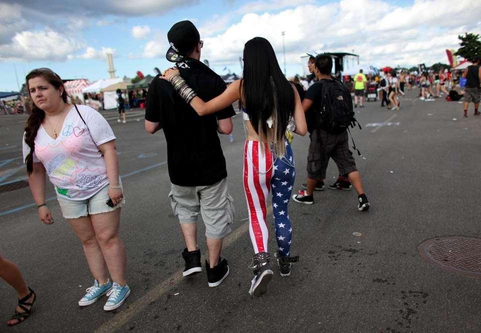 Concertgoers linger in the parking lot Saturday during