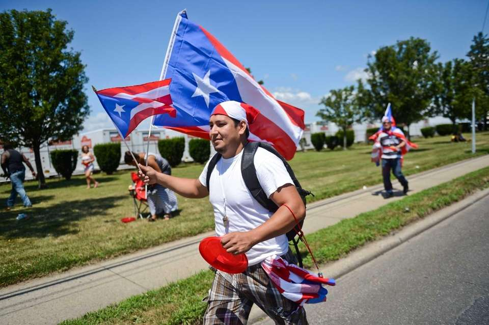 Johnny Castro, of Brentwood, walks down Fifth Avenue