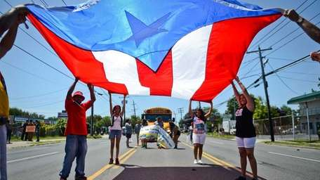 Members of the Puerto Rico Coalition for a
