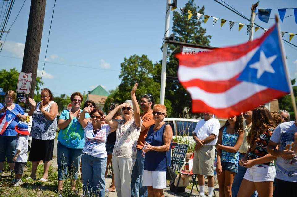 Parade-goers line Fifth Avenue in Brentwood to watch