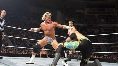 Dolph Ziggler, left, about to hit his opponent.