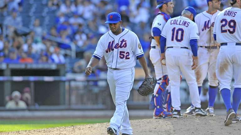 Ramon Ramirez walks to the Mets dugout after