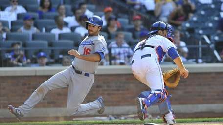 Dodgers' Andre Ethier scores in the 12th inning.