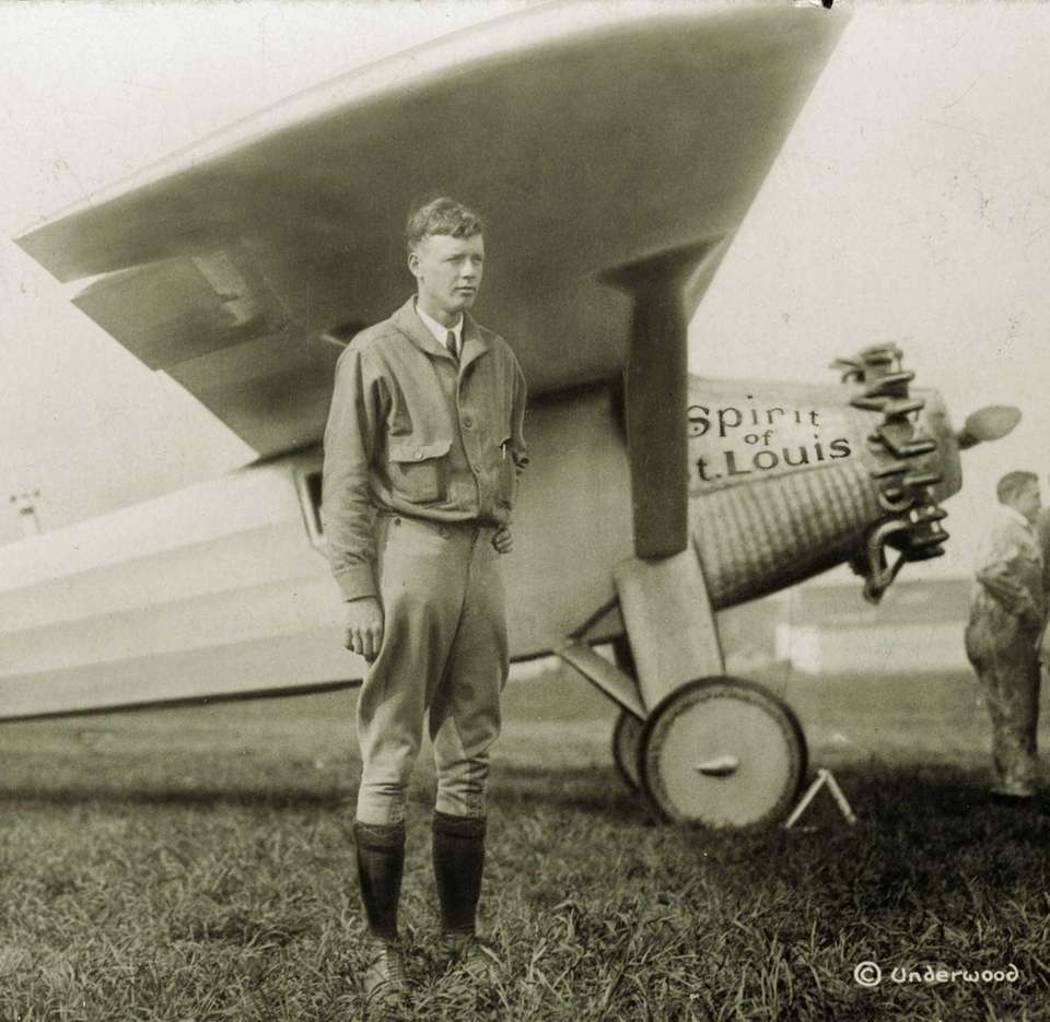 1928: Charles Lindbergh poses with his famous plane,