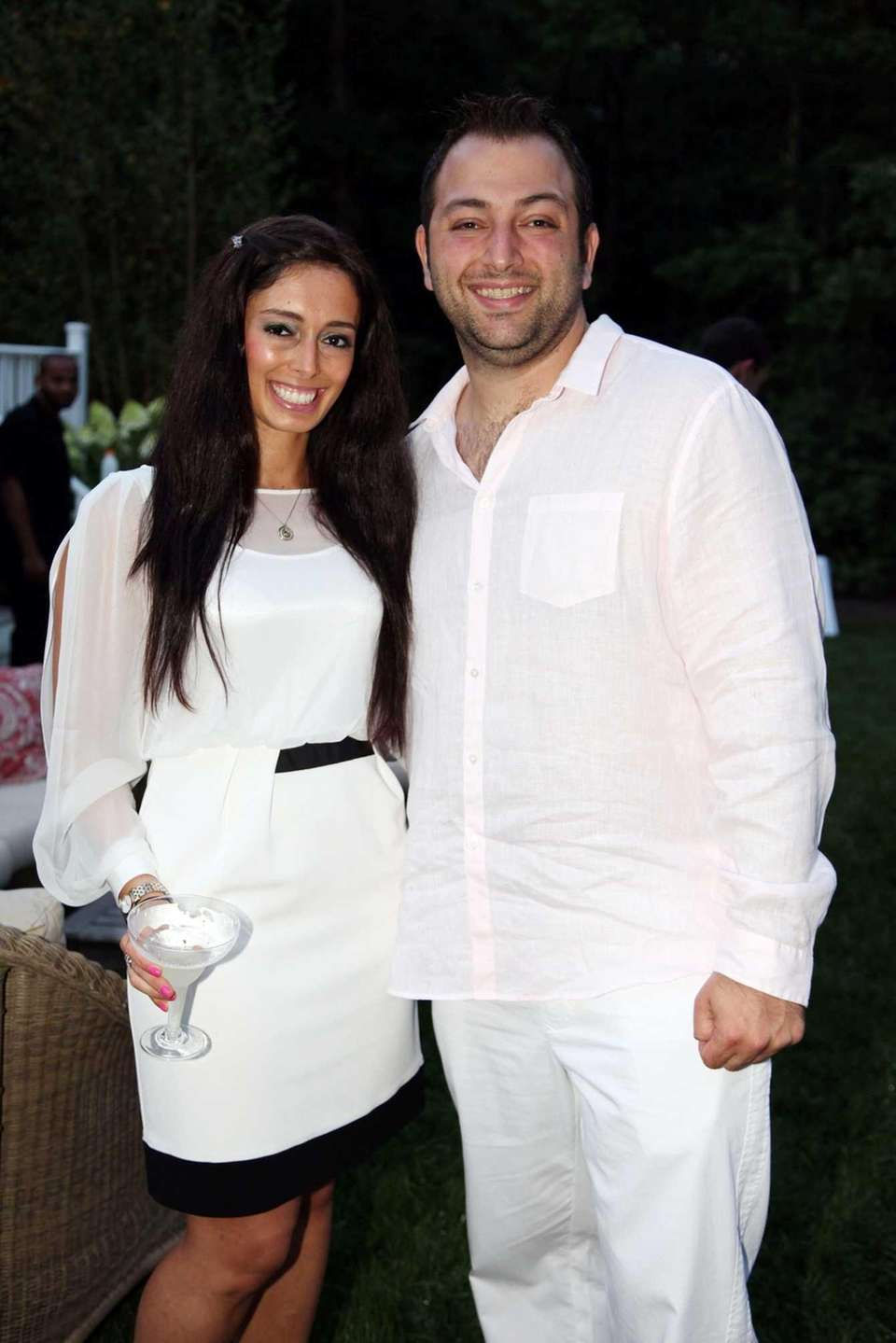 Sarah Schaefe and Justin Glazer attend the Hamptons