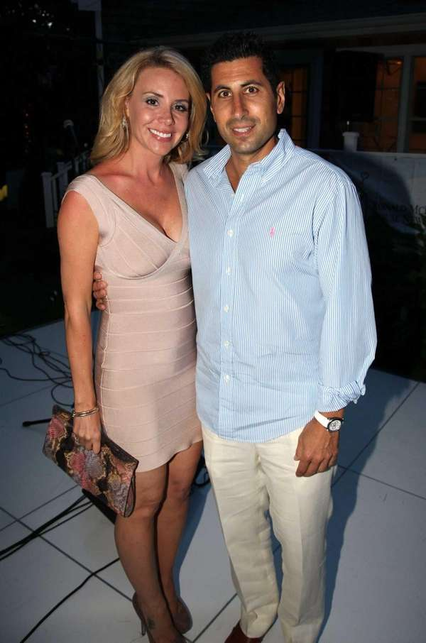 Sandra Silverman and David Silverman attend the Hamptons