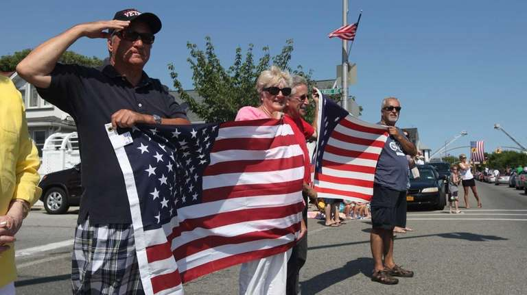 Spectators show their patriotism as they observe the