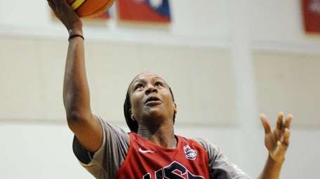 Tamika Catchings drives to the basket during Team
