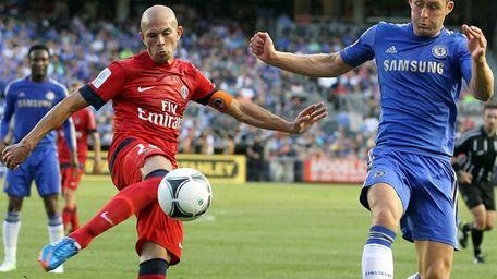 Paris St. Germain's Christophe Jallet fires at the