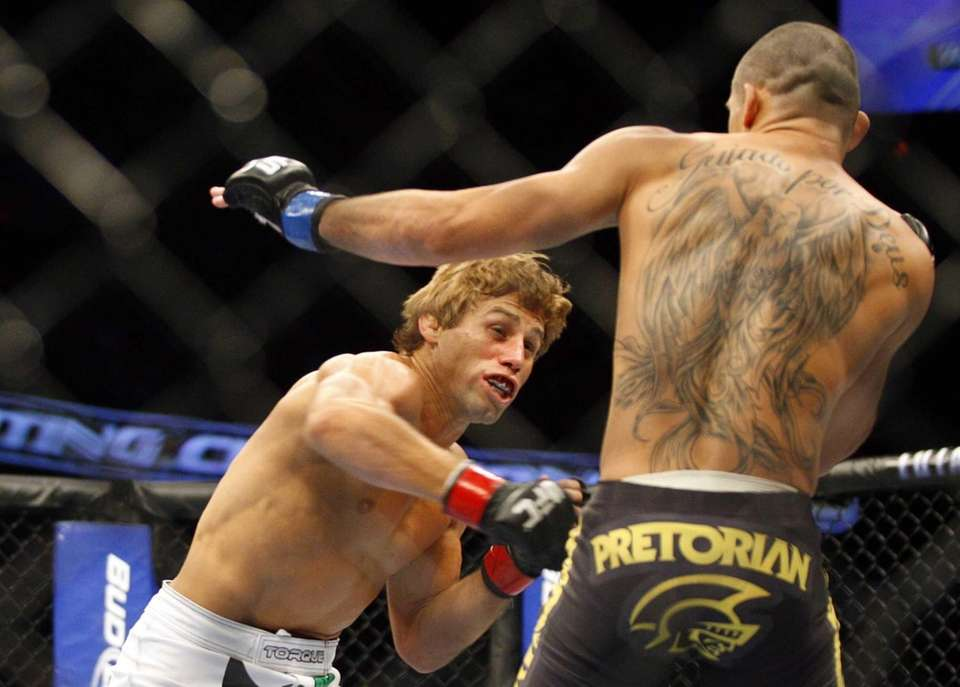 Ultimate Fighting Championship fighters Urijah Faber, left, from