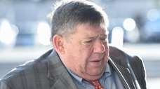 Thomas Murphy enters Suffolk County Court in Riverhead