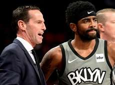 Nets head coach Kenny Atkinson speaks with Kyrie