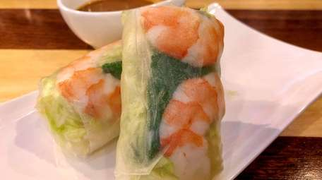 Shrimp summer rolls are served with peanut sauce
