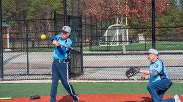 Rein Griesmer, 75, takes a swing as Ray