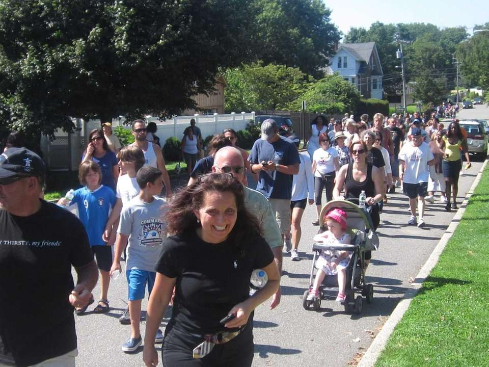 Hundreds walk along Elm Street in Huntington to
