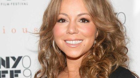 Mariah Carey beams at the 2009 New York