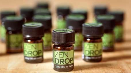 Vials of CBD oil are displayed at the