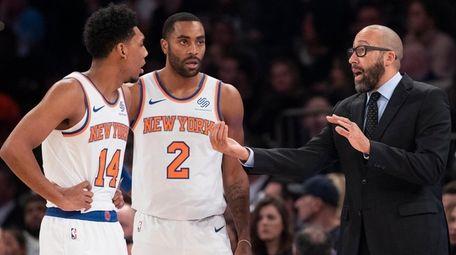 Knicks coach David Fizdale, right, talks to guard