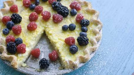 Cottage cheese pie topped with fresh berries. (July