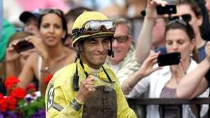 Jockey John Velazquez celebrates after riding Union Rags