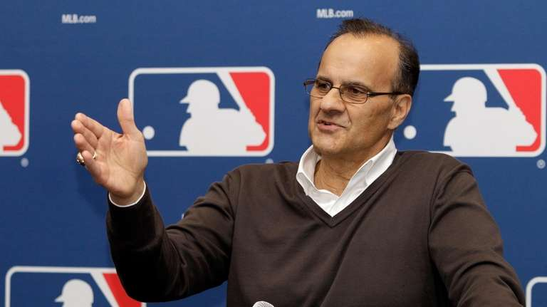 Joe Torre fields questions during a news conference