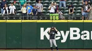 Yankees outfielder Ichiro Suzuki adjusts his sunglasses as