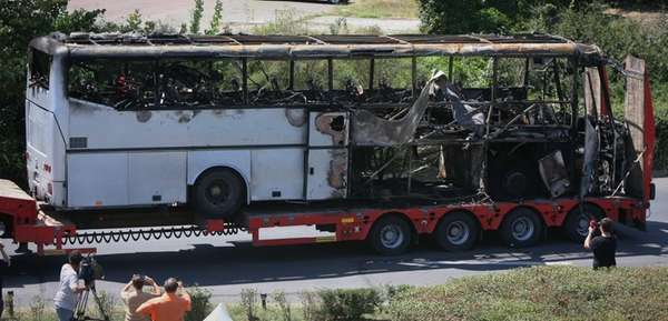 A damaged bus is transported out of Burgas