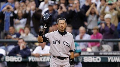 Ichiro Suzuki doffs his batting helmet as fans