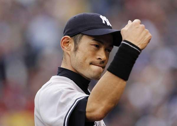 Ichiro Suzuki heads into the dugout after catching