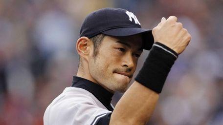 Ichiro Suzuki heads into the dugout after catching