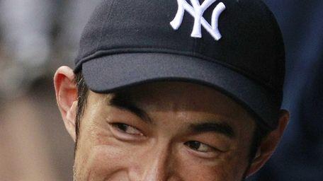 New York Yankees' Ichiro Suzuki smiles as he