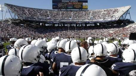 The Penn State football team gathers on the