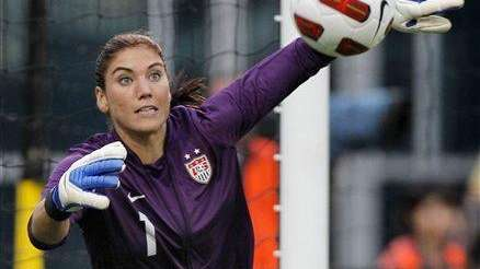 U.S. goalkeeper Hope Solo dives for a shot