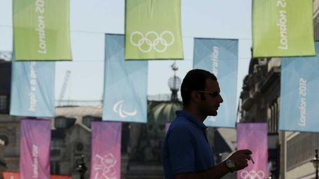A man crosses Haymarket Street against a backdrop