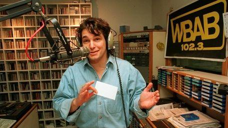 Morning DJ Bob Buchmann at his microphone at