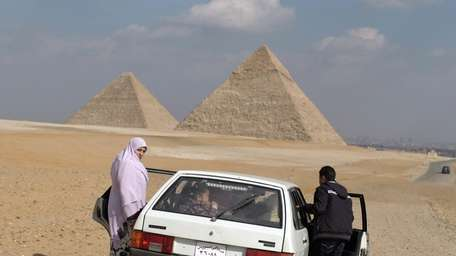 An Egyptian woman and her family visit the