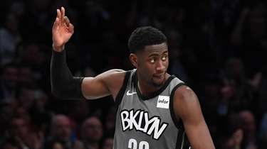 Nets guard Caris LeVert reacts after he sinks