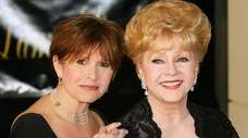 Carrie Fisher and her mother, Debbie Reynolds, arrive