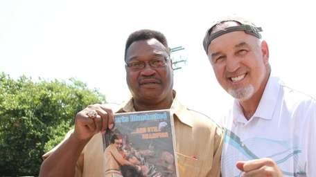 Former professional boxers Larry Holmes, left, and Gerry