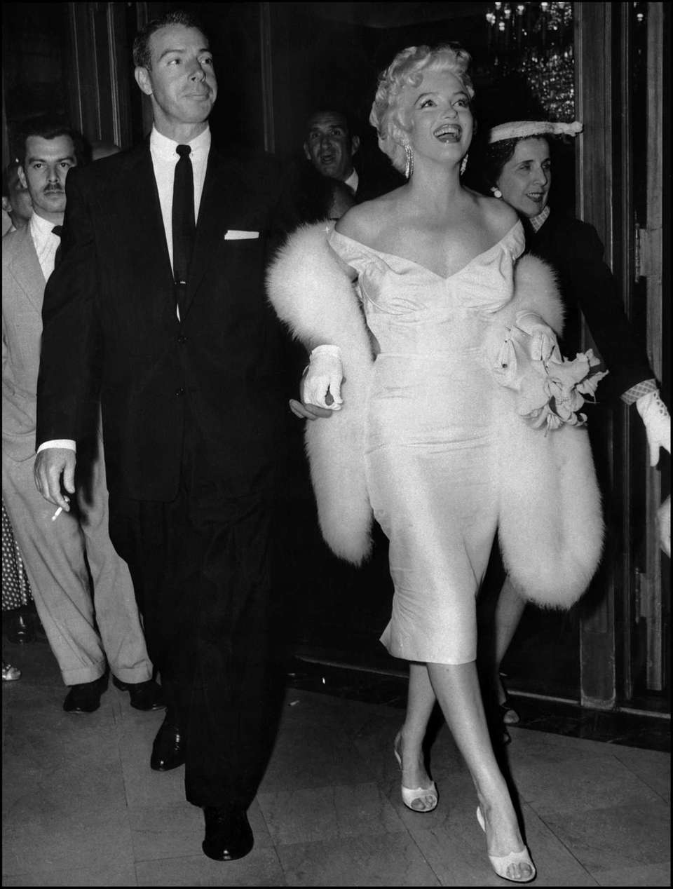 Actress Marilyn Monroe walks with her husband and