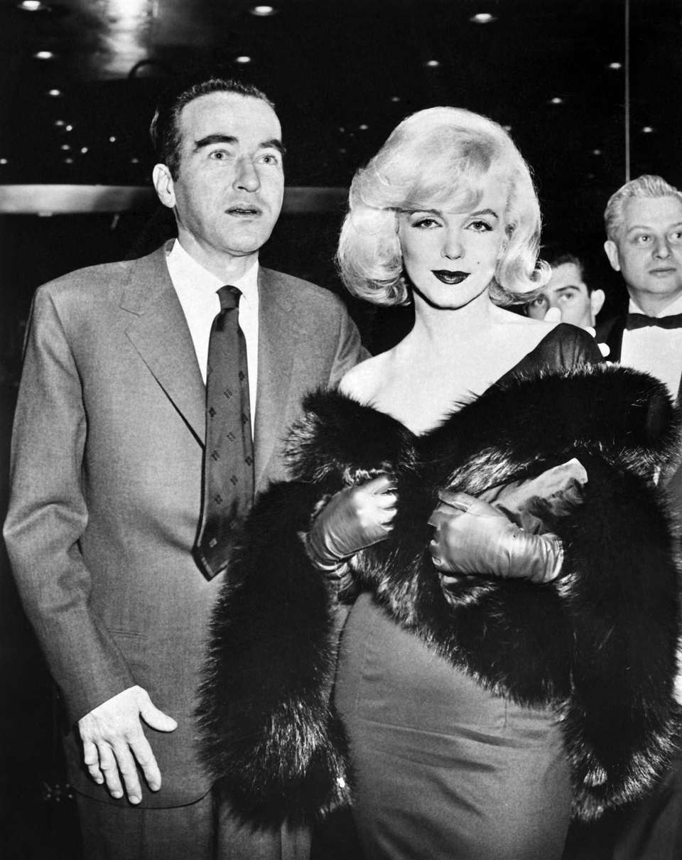 Actors Marilyn Monroe and Montgomery Clift pose in
