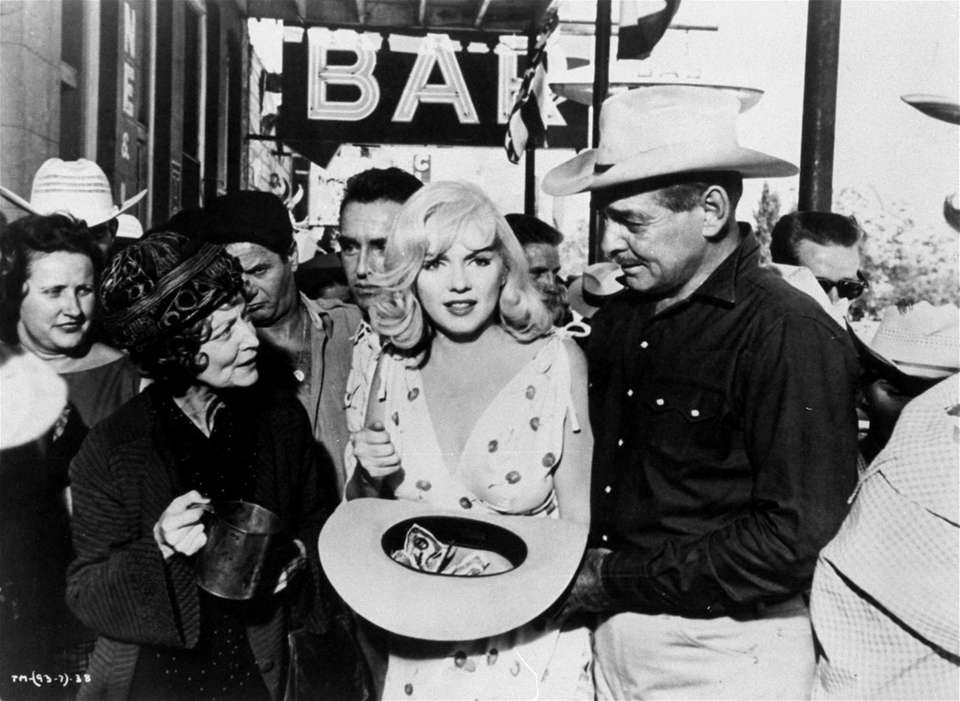 In this scene, Marilyn Monroe walks with Clark