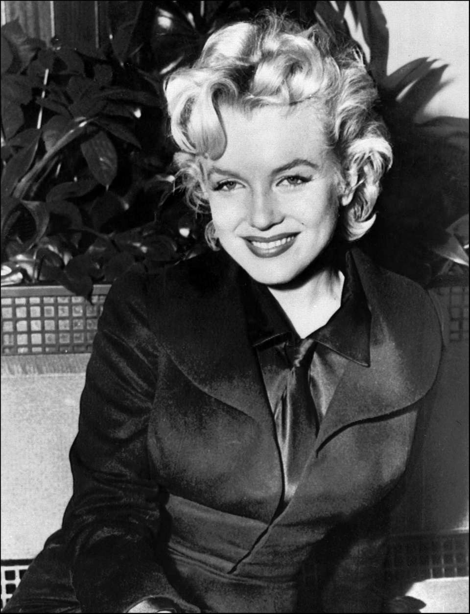 Actress Marilyn Monroe smiles for the camera a