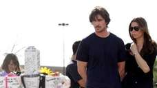 Christian Bale and his wife visit memorial across