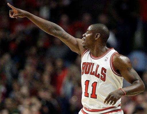 Chicago Bulls guard Ronnie Brewer points toward his
