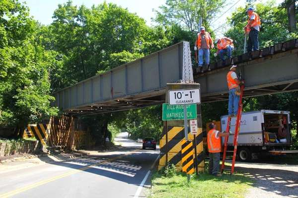 LIRR workers begin repair work on the bridge