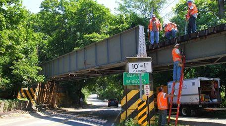 LIRR workers begin repair work on the bridge