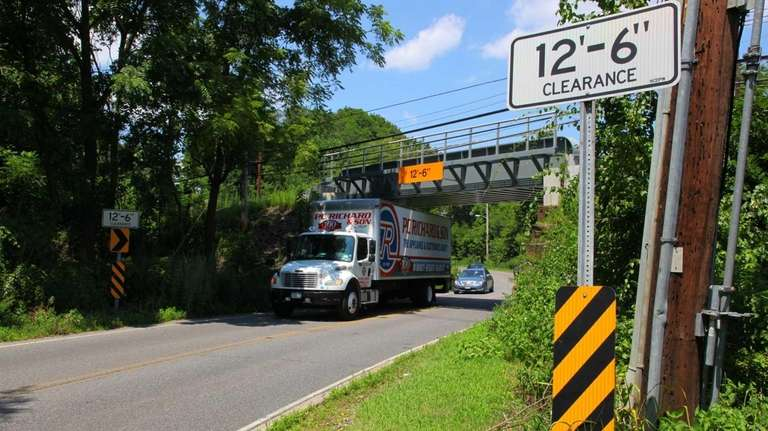 A truck passes under the 12 foot 6