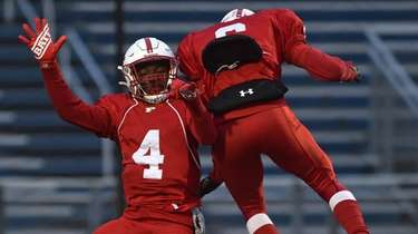 Terrance Edmond #4, Freeport quarterback, left, gets congratulated